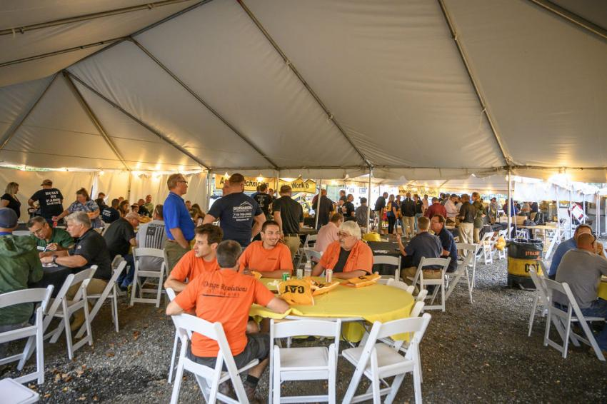 Attendees gather for a delicious dinner served under the tent.