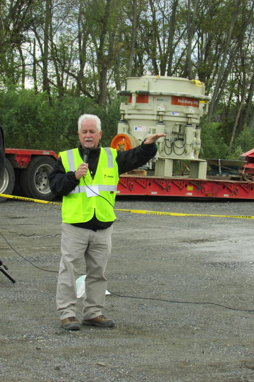 Tom Jamieson, general manager of Cleveland Brothers CB Con-Agg, explains the live crushing and screening setup to guests during the event.