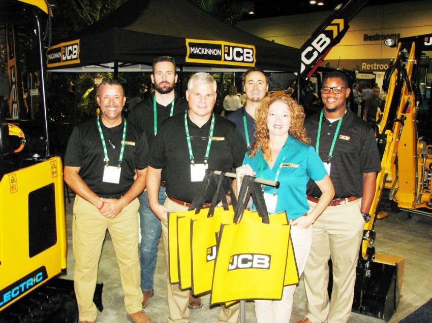 (L-R): The representatives of MacKinnon JCB, Mark Kollar, Austin McCoy, John Miller, Billy Burr, Amada Johnson and Darius Prentice packed a whole lot of JCB machines into their exhibit area including the first JCB electric mini-excavator.