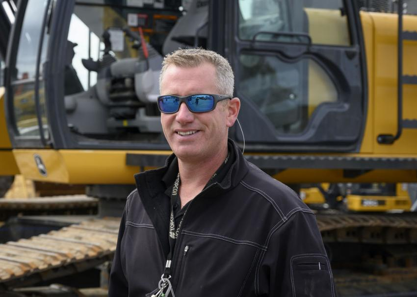 Derrick Ward, Topcon territory manager, spoke about his company's display of surveying equipment and gave guests the opportunity to test out Topcon GPS technology on John Deere's 470G hydraulic excavator.