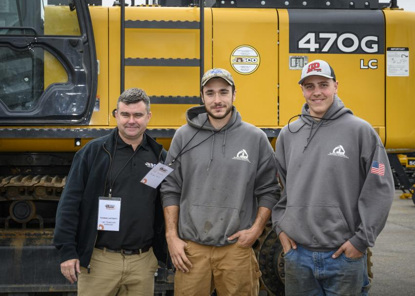 (L-R): Thomas Lafferty, C&F territory manager; Rob Buchanan and Ryan Wertz, both of Middle Island in Coram, N.Y., stand in front of the John Deere 470G hydraulic excavator.
