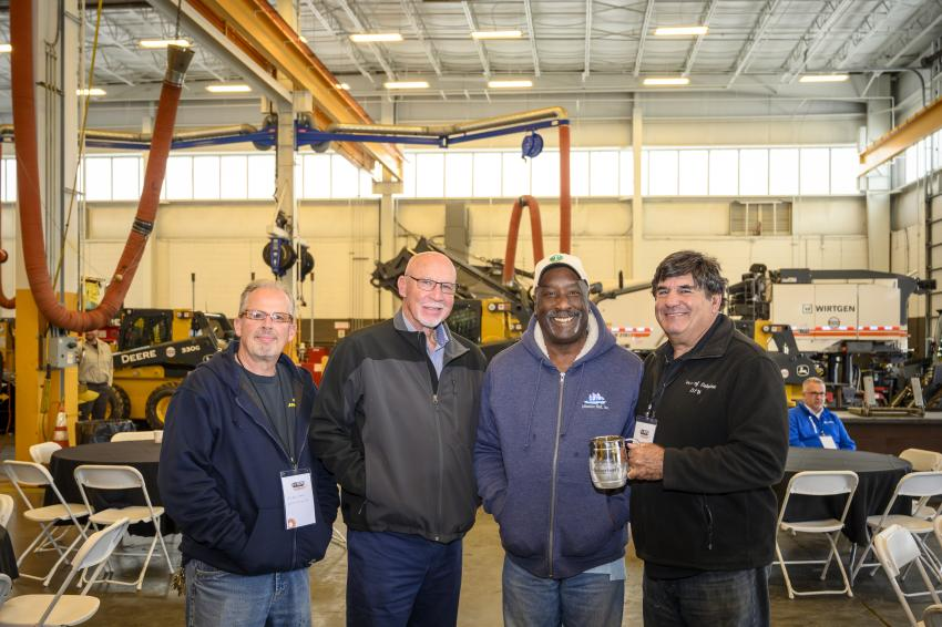 (L-R): Matt Roberts of Suffolk County DPW; Ed Farrell of E.E.J.S.; George Woodson; highway superintendent of Riverhead, N.Y.; and Tom Martin of the town of Babylon, N.Y., enjoying a catered lunch of German food.