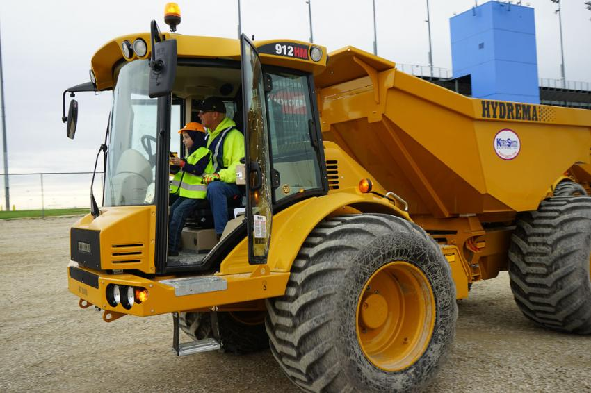 Kids are given the chance to operate dozers, excavators and other machines as professional operators guide them.