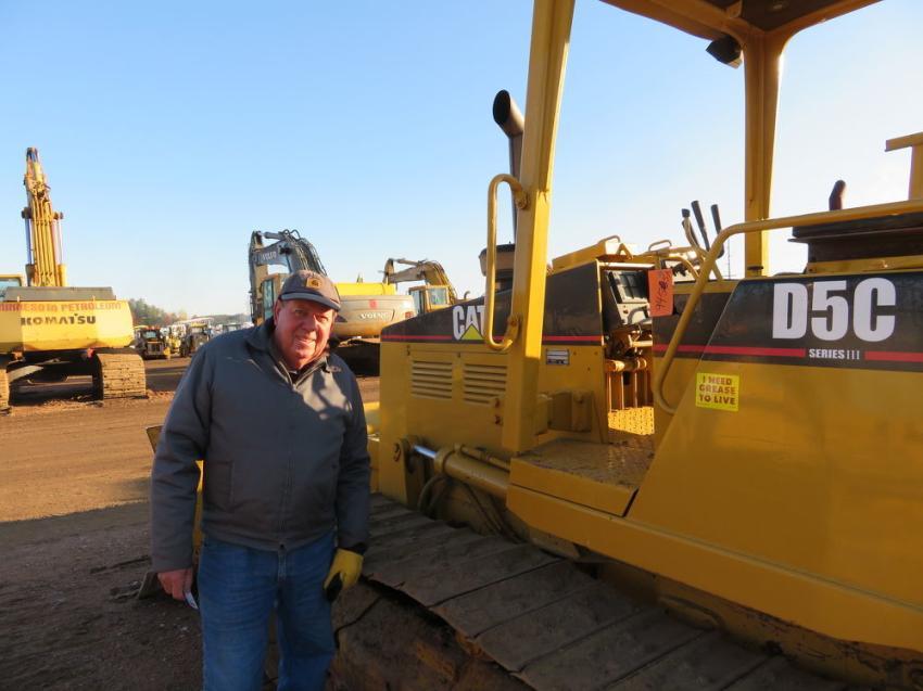 John Mashak of Mashak Construction checks the undercarriage of this Cat D5C dozer.