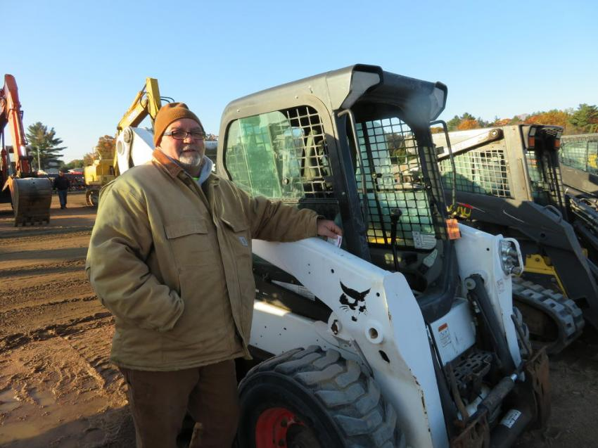 Dave Bitter of Bitter Construction inspects this Bobcat S750 skid steer.