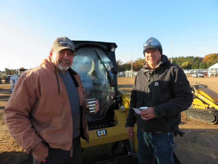 David (L) and Glen Schultz of Lakeview Maintenance and Ponds Plus have been coming to the annual auction for many years. Today, they are looking over the track skid steers.