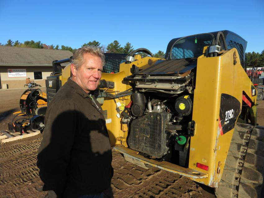 Checking the engine of this Cat 279C skid steer is Ray Wingert of Ray's Machinery and Auto.