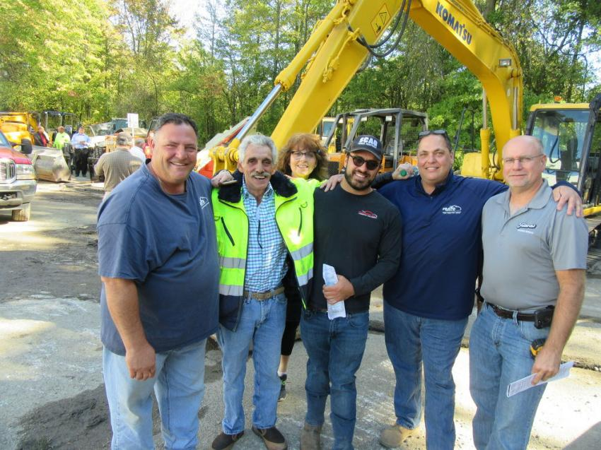 (L-R): Anthony Frato of Frato Products; George Kafantaris of Industrial Painting and Rigging; Sheila Rosen of Rosen & Company; Mike Camaglia of CustomPak; Joe Frato of Frato Products; and Emil Fabrizi of Fabrizi Trucking and Paving take a break from auction activities to catch up.