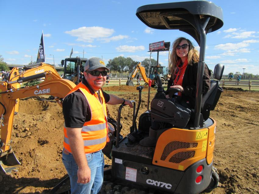 Case Construction Equipment's Garrett Campbell (L) reviews features of the CX17C mini-excavator with Morgan Wade of Charles Henrick's Landscaping.
