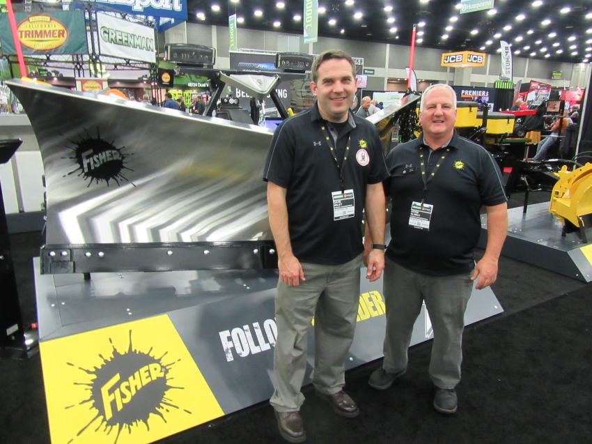 Dave Wiley (L) and Norm Klimko of Fisher Engineering were ready to discuss the company's recently launched 10-ft. 6-in. heavy-duty XV2 v-plow.