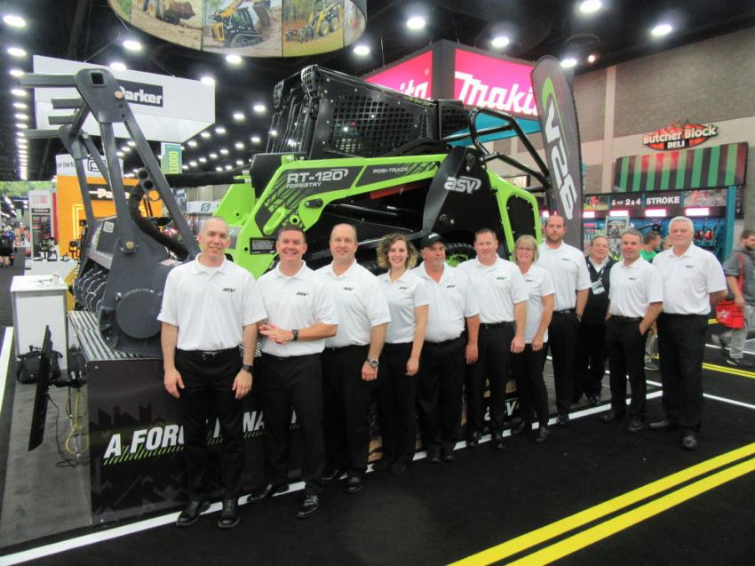 Representatives of ASV showcase the special edition Green Beast, a green and black version of the RT-120 forestry compact track loader.