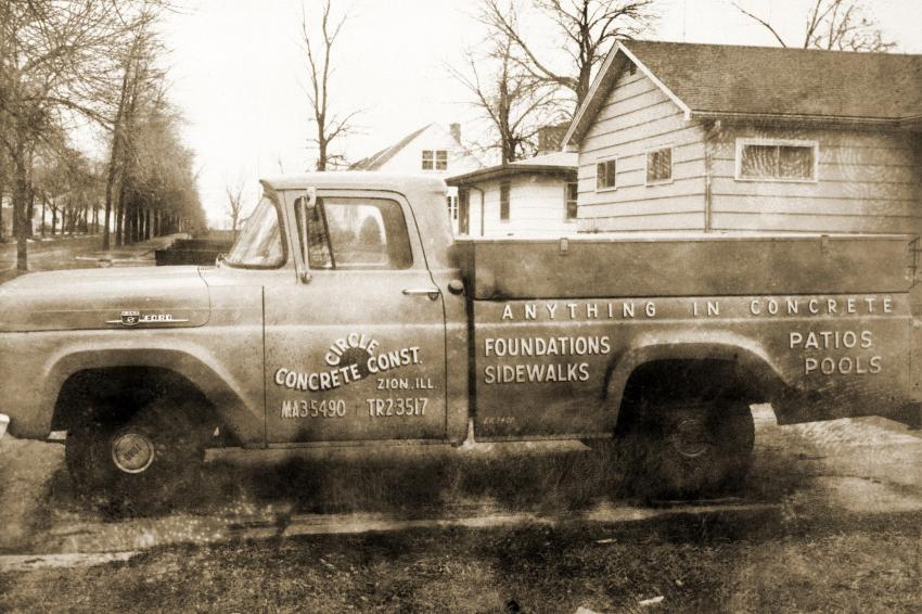 """Circle Concrete's original truck with its logo """"Anything in Concrete"""" on the side."""