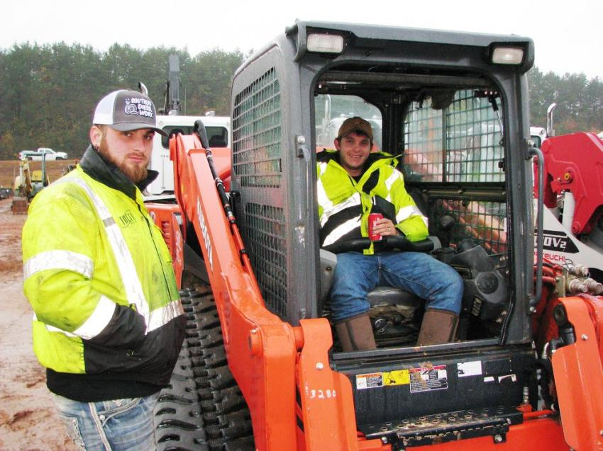 Looking over a nice Kubota SVL 95-2s compact track loader are Gabe Baird (L) and John Rinel (in cab) of Ranger Tree Service, Canton, Ga.