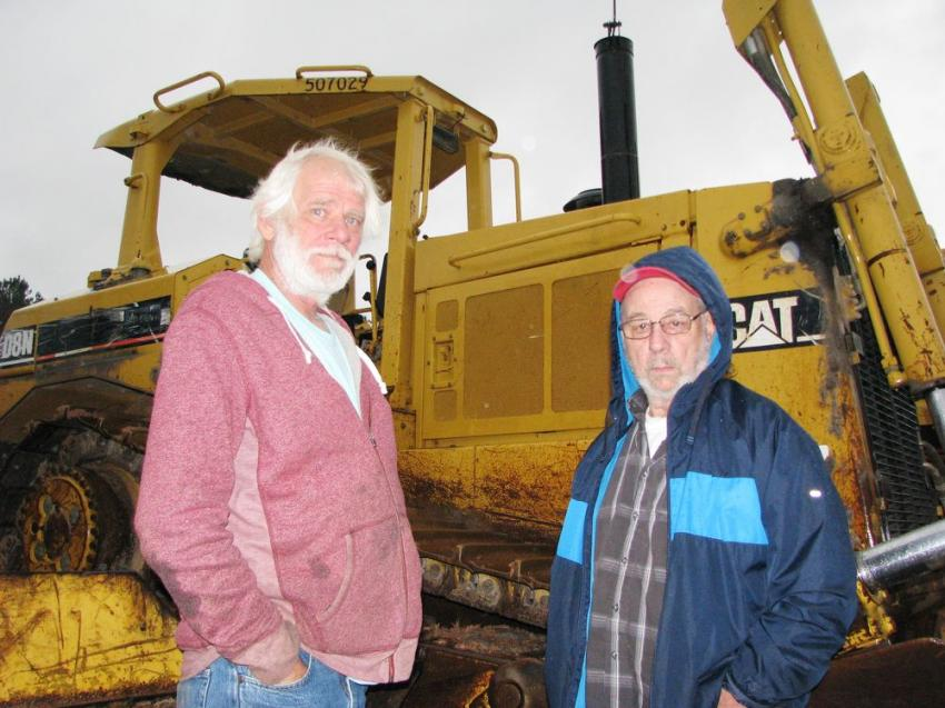 Interested in some of the big iron in the sale line-up including a Cat D8N are William Thompson (L) of Thompson Grading & Hauling, Temple, Ga., and Robert Ingram of P/R Inc., Acworth, Ga.