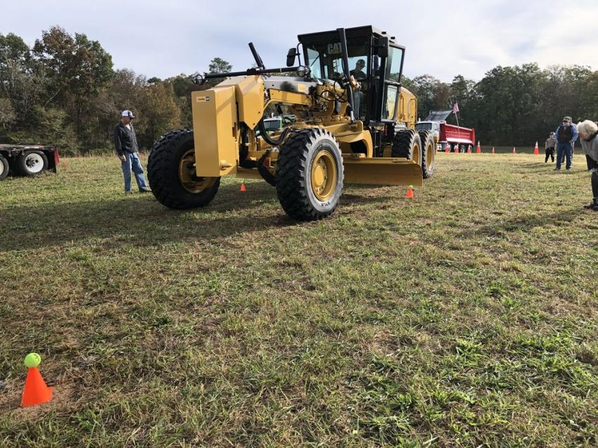 With the help of Cat 140 motorgrader, contestants had to knock 12 tennis balls off the cones