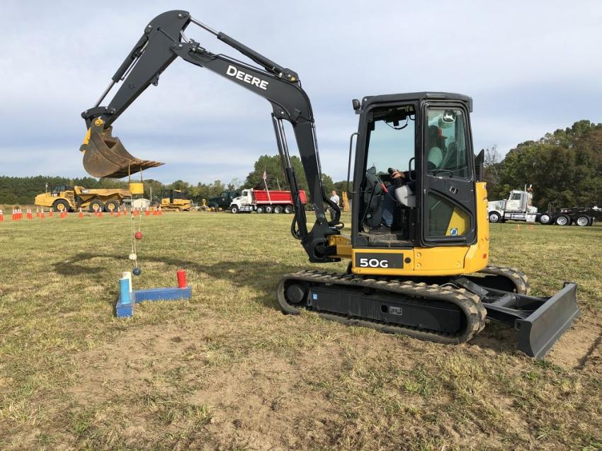 Using a John Deere 50G mini-excavator, contestants competed in the ball drop.