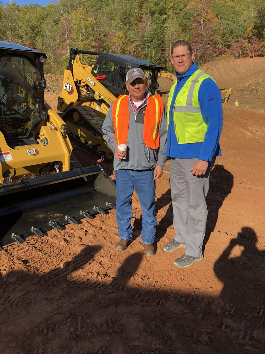 Denny Ensley (L) of Housing & Community Development for the Cherokee Indians, gets an overview of the new D Series Cat compact track loaders from Steve Norton of Carolina Cat.
