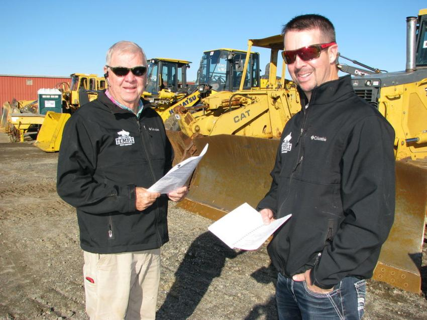 Enjoying a picture-perfect day for auctioning and waiting for the big iron to go on the block are Tim Temple (L) and Matt Temple of Temple Heavy Equipment, Huntersville, N.C.