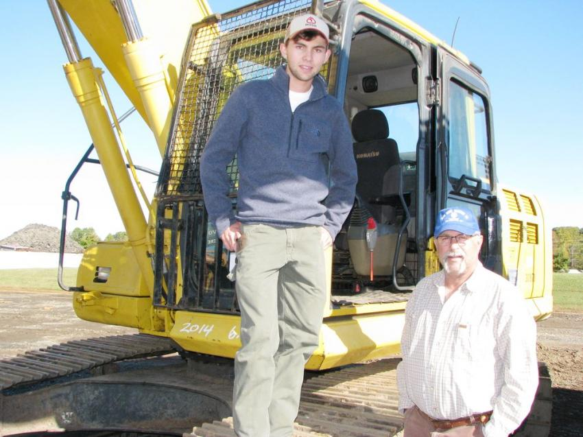 Farming operations registered bidders, Caleb Gilreath (L) and his dad, Brad Gilreath of Taylorsville, N.C., were looking to catch a bargain on a Komatsu PC210LC of interest.