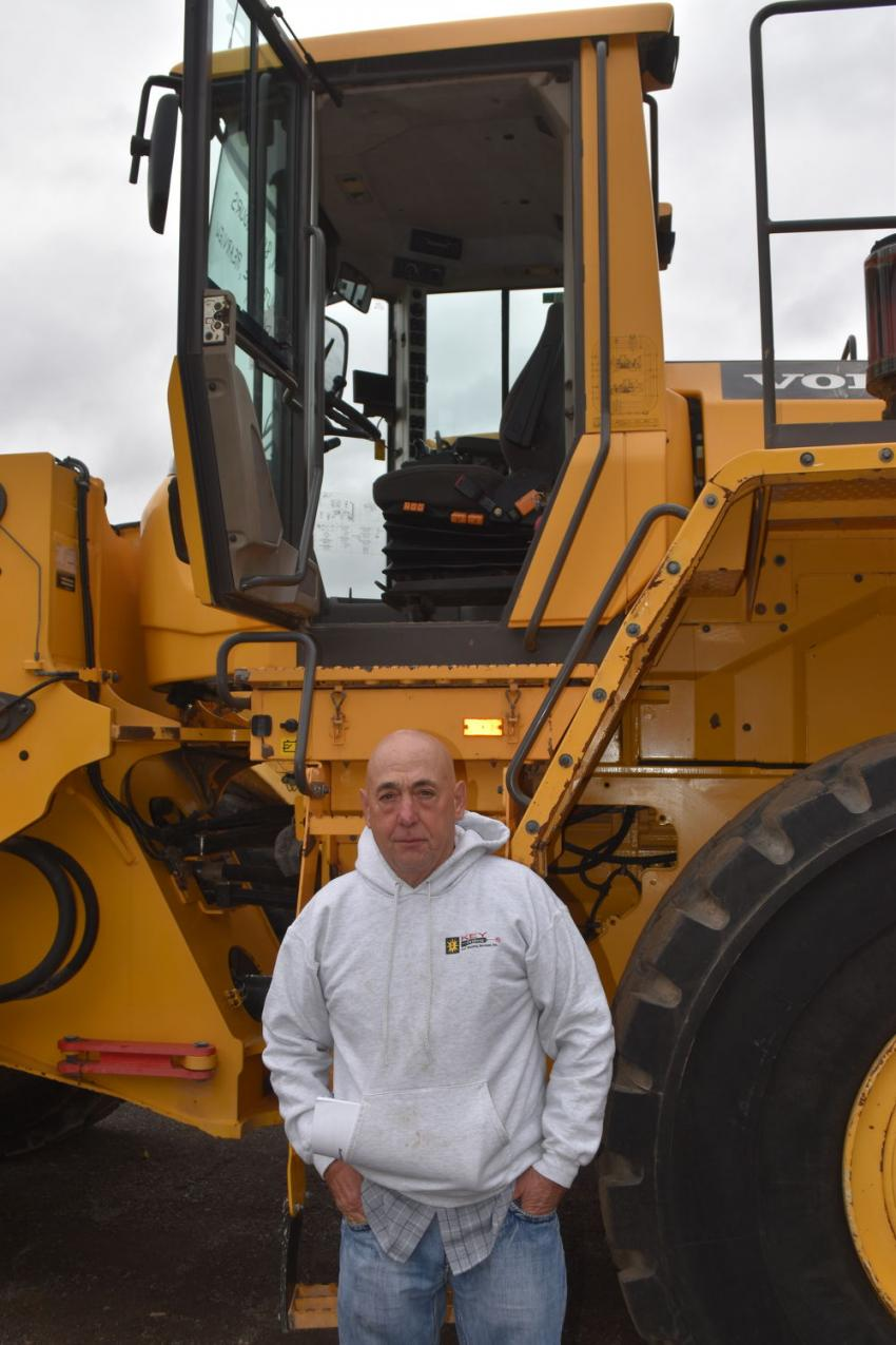 As has come to be expected, the Sales Auction autumn event had a very nice selection of loaders perfect for snow removal, including this Volvo L150G.  Mike Renaud of Renaud Brothers Construction in Vernon, Vt., gives a big thumbs up after a presale inspection.