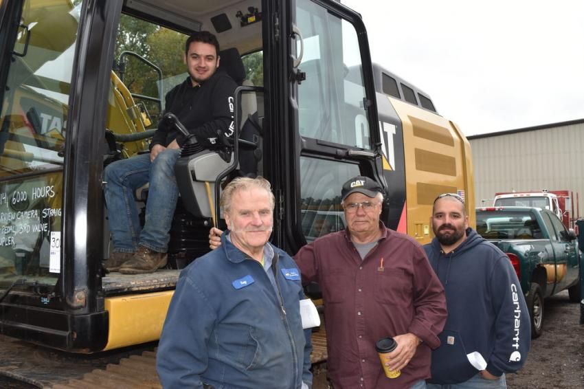 Checking out this late model Cat excavator are Travis Quinlan from Shelton, Conn.; Jim Hayward of Hayward Construction in Belchertown, Mass.; Ray Basara of Karl Excavating in Hadley, Mass; and Justino Rua of Justino's Landscaping LLC in Monroe, Conn.
