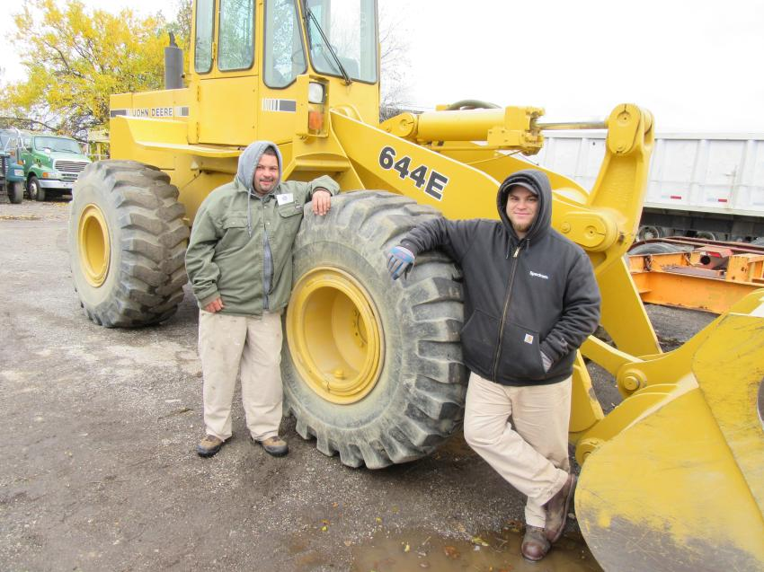 Mike Spates (L) of Nature One Landscaping and Mark Williams of MW LLC Landscaping take a look at the John Deere 644E wheel loader at the auction.