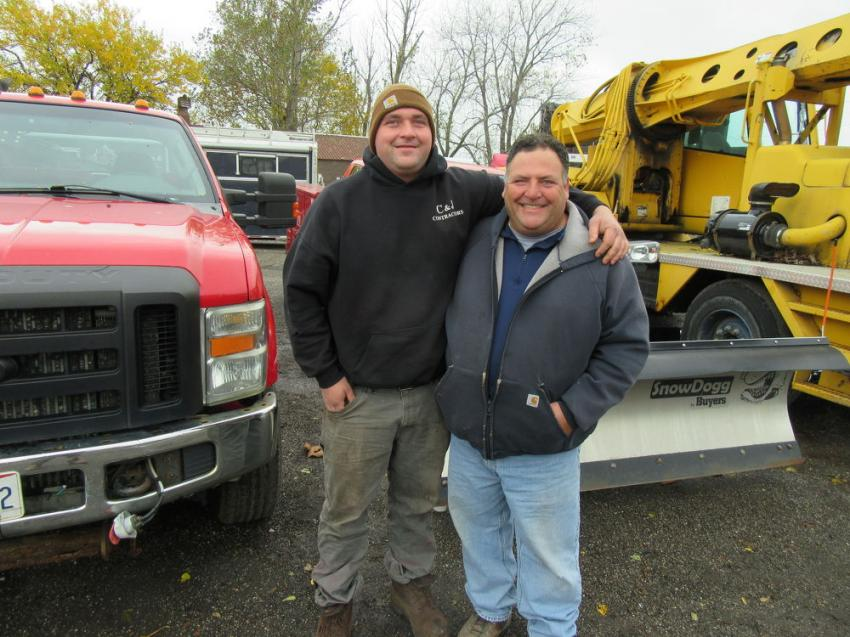 Joe (L) and Anthony Frato of Frato Products spent time in the equipment yard reviewing the trucks up for bid.