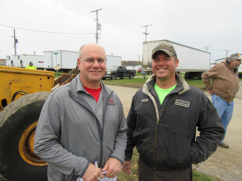 Emil Fabrizi (L) of Fabrizi Trucking and Paving joined Steve Chek of Lakeside Sand and Gravel to review the equipment.
