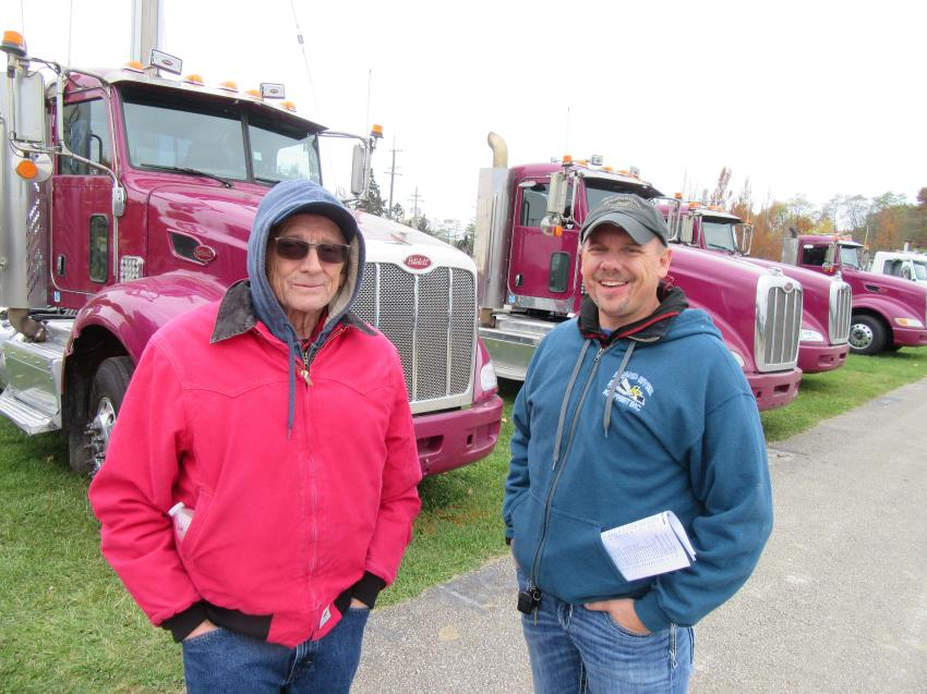 Dennis Brewer Sr. (L) and his son, Dennis Jr., of Grand River Equipment were interested in a wheel loader and the trailers.