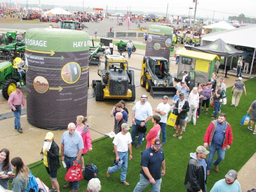 Both yellow construction iron and green ag machines lined the massive John Deere exhibit area.