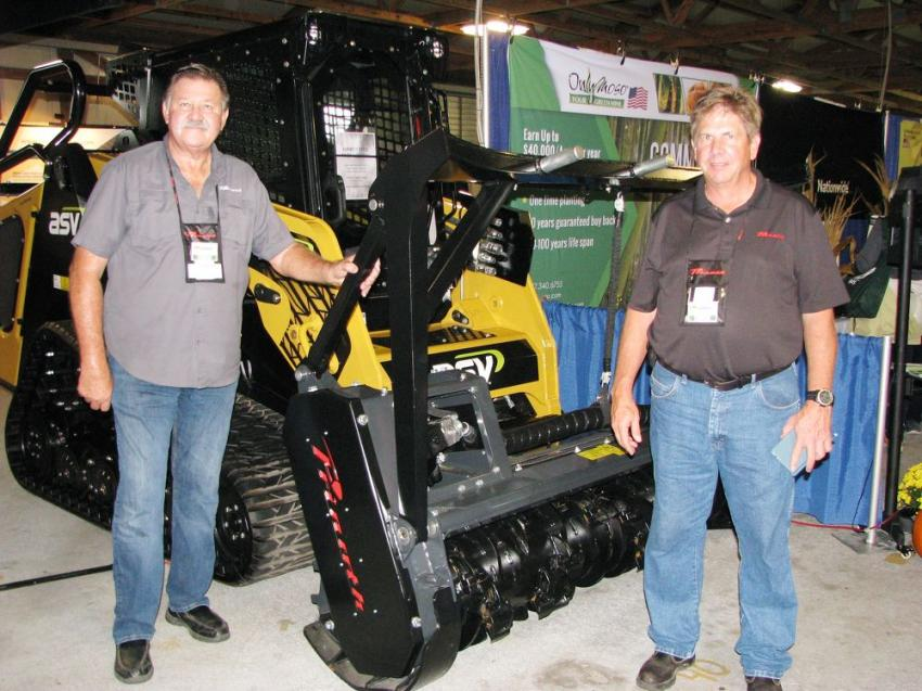 Scott Brown (L) and Frank Hollowell, Prinoth factory reps, chose an indoor exhibit to showcase their vegetation management machines and attachments.