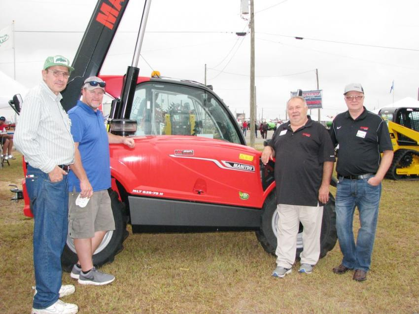 In the Don Allison exhibit talking about the Manitou MLT 625-75H telehandler on display (L-R) are John Schoessow of S.I. Feeders; Chris Ergle, Don Allison Equipment; and John Rau and Mike Disser of Manitou.
