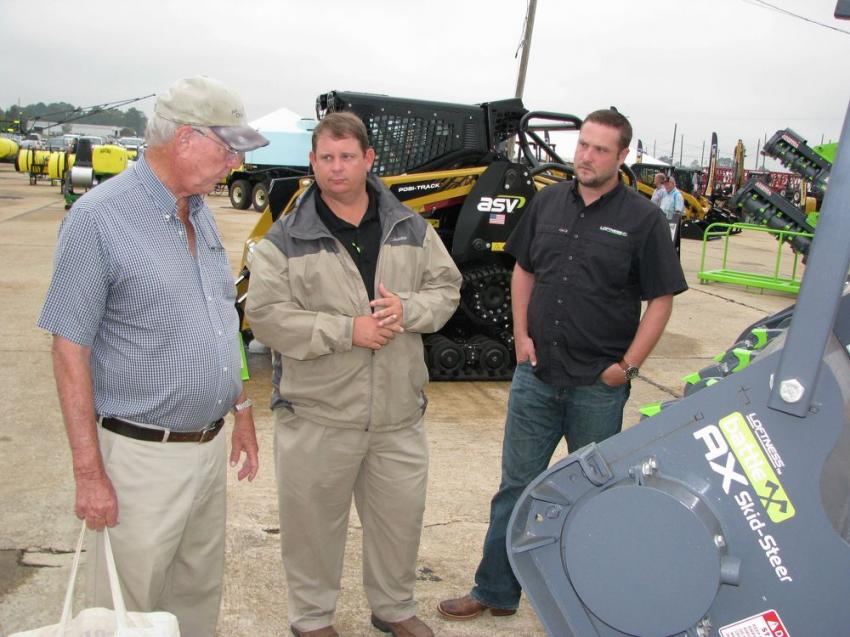 Deep in discussion of the attachments in the Loftness exhibit area (L-R) are Fred Webb, a farmer based in Panama City, Fla.; Neil Rountree, MacKinnon JCB; and Blake Eavenson of Loftness Mfg., Ortonville, Mich.