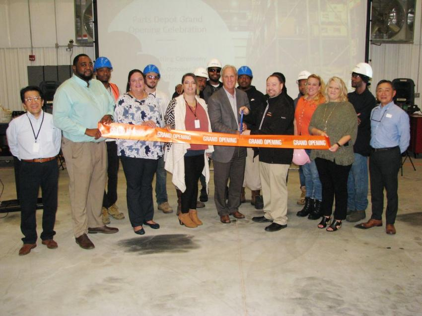 Brian Borders and his parts warehouse team step to the stage for their ribbon-cutting ceremony.