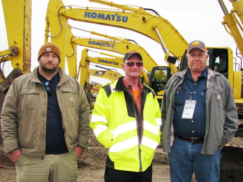 Interested in the four Komatsu PC 360LC excavators in the sale lineup (L-R) are Chris Knight, Calvin Rockwell and Horace Knight of K & K Services, Tibbie, Ala.