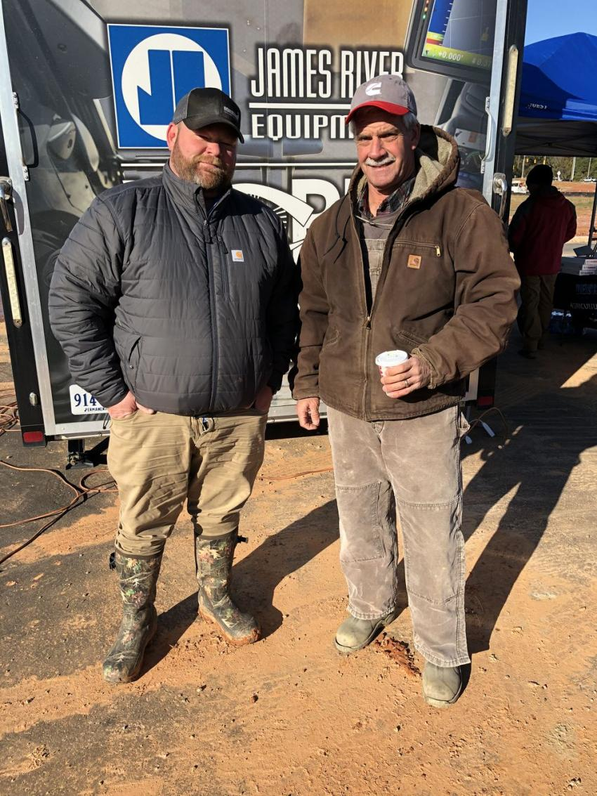 Andy Pugh (L) of Benchmark Tool & Supply goes over the event of Ken Smith of Odell Smith & Sons in Fayetteville, N.C.