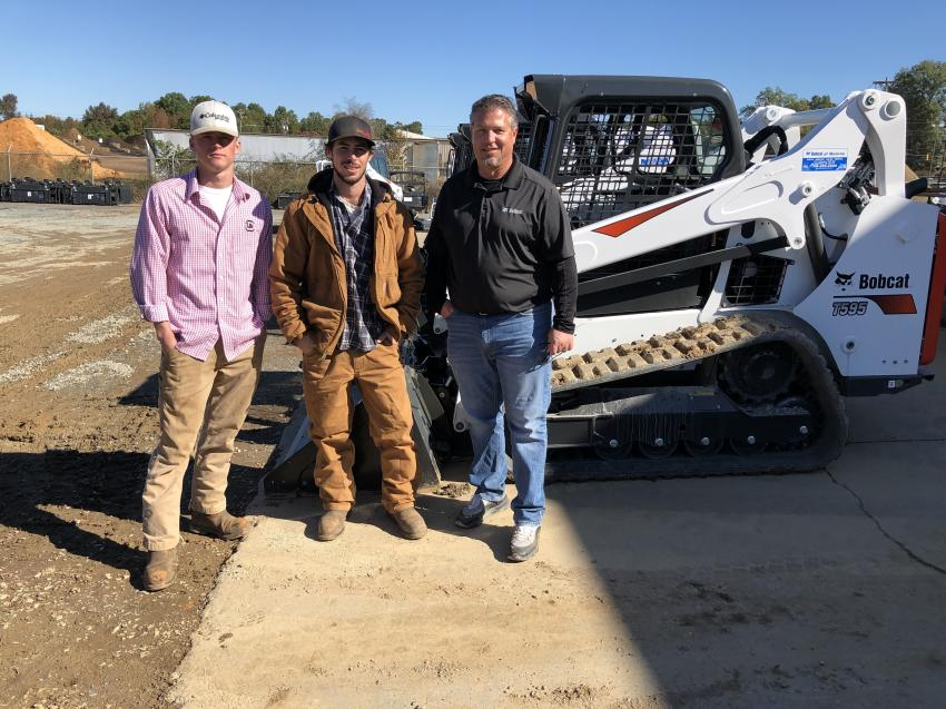 Discussing a Bobcat T595 track loader is Alec Hensley and Braeden Evans, both of Beavers Clearing & Grading in Lancaster, S.C., and Dan Bebe of Bobcat of Monroe.