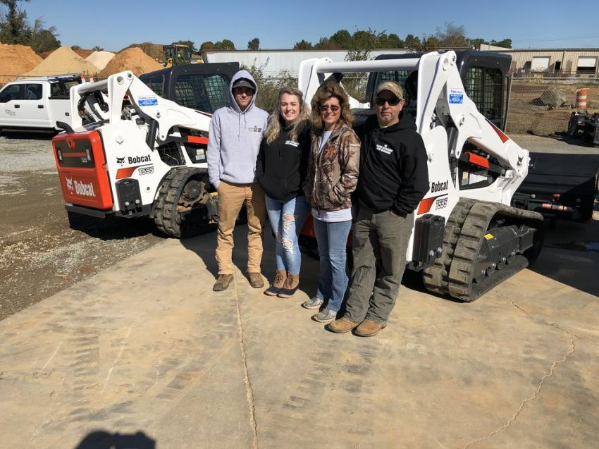 Tyler, Kayla, Christy and Scott, all of 4K Land Clearing & Grading in Lancaster, S.C., check out the popular Bobcat T595.