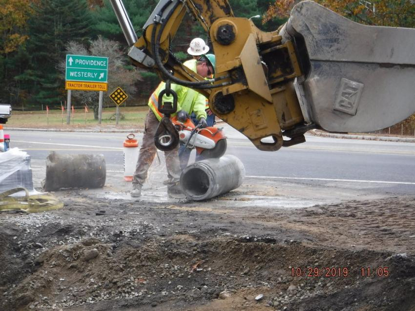 Workers install drainage pipes, catch basins and electrical conduit.
