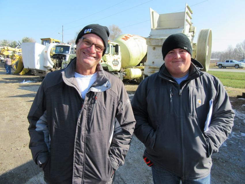 Joe (L) and Casey Jones of Logansport Crushed Limestone, Sand and Gravel review the equipment in the yard.