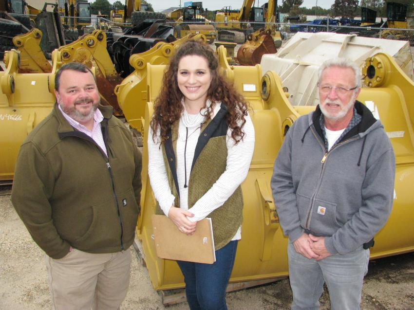 Looking over the attachment inventory before the sale got underway (L-R) are Thompson Tractor sales coordinators Tim Stewart and Cari Gore with their manager, Jim Thompson, who is officially retiring at the end of this year after a 41-year career with Thompson Tractor.