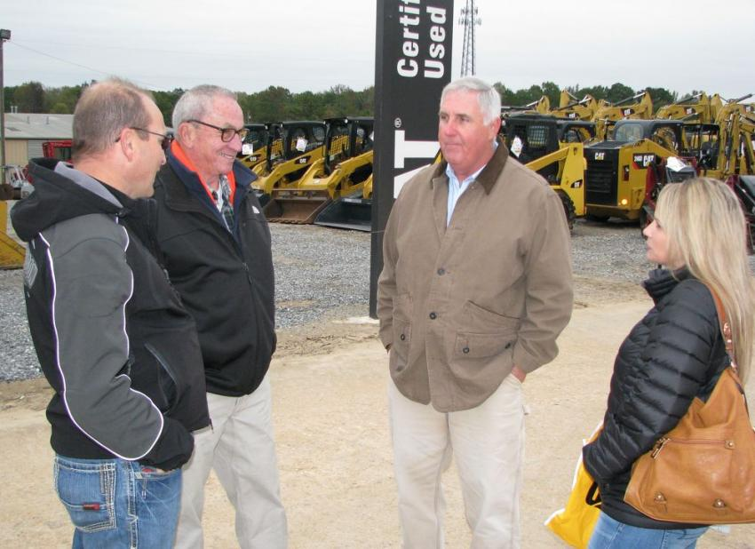 Discussing the machines and great deals at the event (L-R) are Jarrod Honeycutt, independent contractor based in Jasper, Ala.; Terry King and Jeff Pope of Thompson Tractor; and Dena Honeycutt.