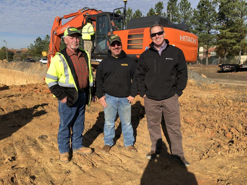 Tommy and T.J. Johnson, both of Johnson Utility & Grading in Statesville, N.C., and John Mooney of Benchmark Tool & Supply.