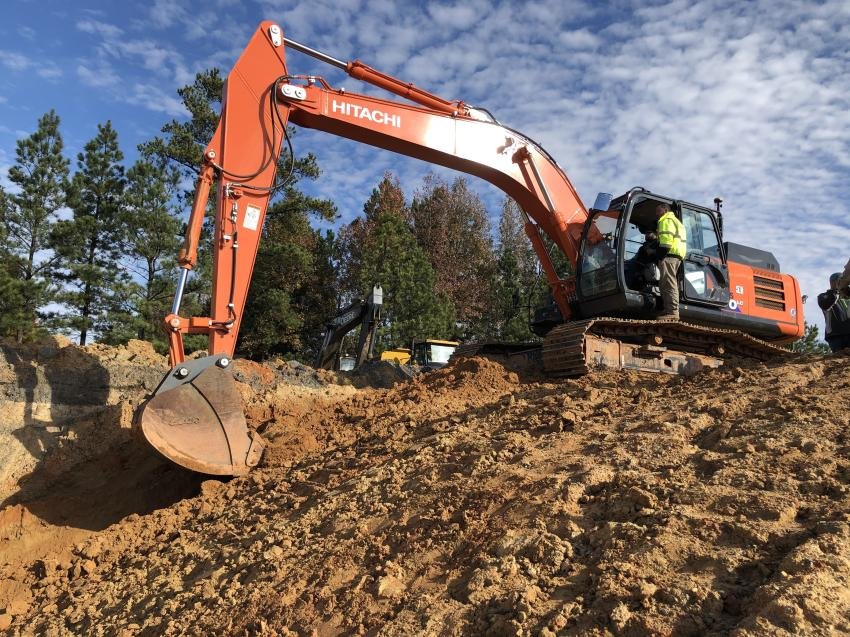 Working on a typical project application, the guests enjoyed the opportunity to test out the Hitachi 300 excavator equipped with the X-53x Topcon system.