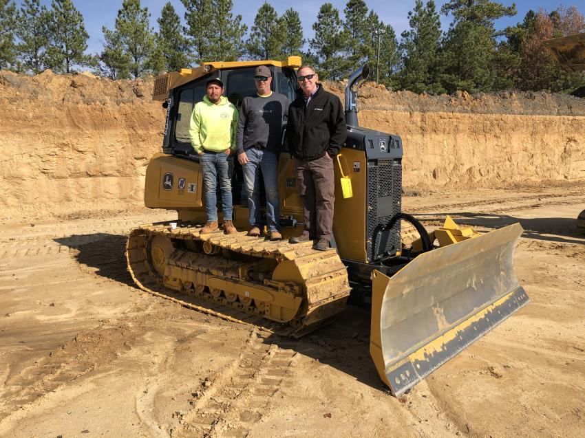 Discussing how well the Topcon systems help with grading productivity (L-R) are Raul Cruz and Crater Lewis, both of Jimmy Lewis & Sons Grading in Roxboro, N.C., and John Mooney of Benchmark Tool & Supply.