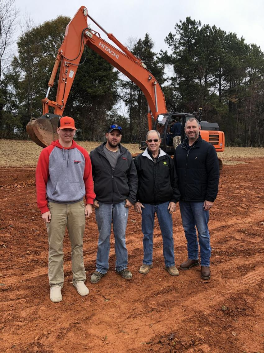 From the left are Bryce Hennings and Dusty Lindsay, both of Hennings Construction in East Bend, N.C., with Warren Cutts and Brocke Walker, both of James River Equipment.