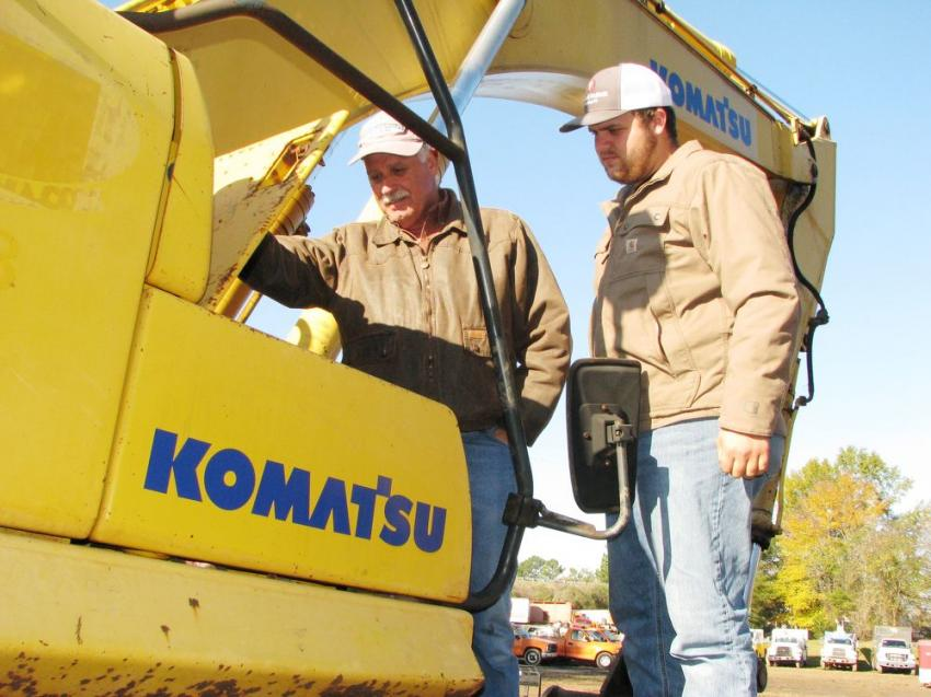 Inspecting a Komatsu PC300 of interest are Terry Mathis (L) and Will Fagan of Mathis Grading, Cumming, Ga.