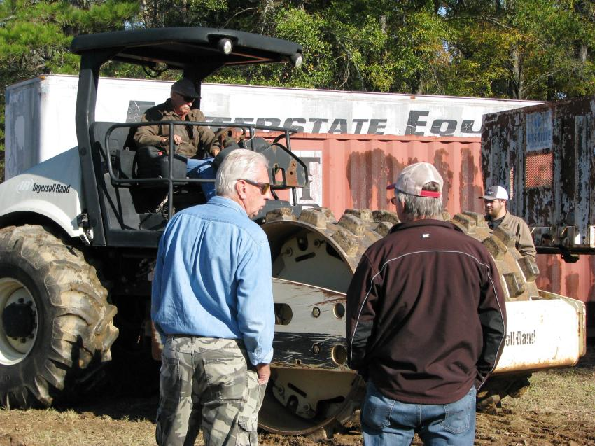Folks came out early to inspect some of the earthmoving and compaction machines before the auctioning began.