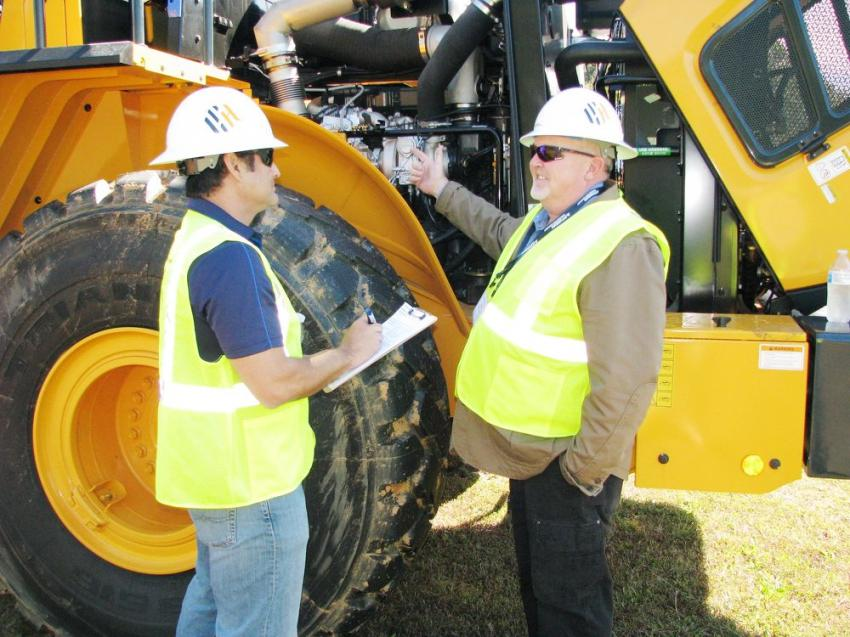 Hyundai's Eli Bello (L), district manager-South Central, gains more info on serviceability of an HL series wheel loader from Eric Cliff, Northeast district service manager.