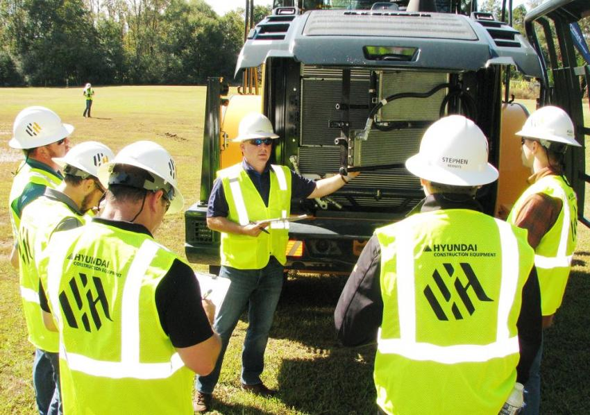 Giving an overview of the cooling package of the Hyundai HL960 wheel loader is Hyundai product manager Ed Harseim.